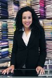 Happy owner of a fabric store. Small business: happy owner of a fabric store royalty free stock images