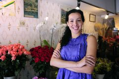 Happy owner of a flower shop. Small business: happy owner of a flower shop stock photography