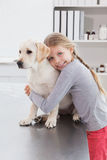 Happy owner hugging her cute dog Royalty Free Stock Image