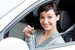 Happy owner of a new car is showing the car key. Royalty Free Stock Photography