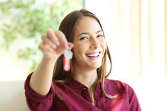 Happy owner or renter showing keys. Happy apartment owner or renter showing keys and looking at you Stock Images