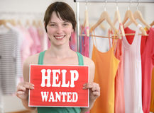 Happy owner of store with help wanted sign Royalty Free Stock Images