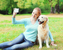 Happy owner woman with Golden Retriever dog taking selfie portrait on smartphone Royalty Free Stock Photos
