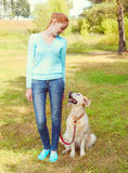 Happy owner woman and Golden Retriever dog walking Royalty Free Stock Photography