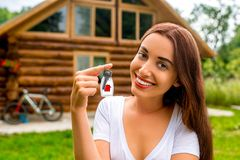 Happy owner of the wooden small cottage Stock Images
