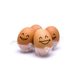 Happy pack of four brown eggs Stock Photo