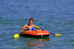 Happy paddling woman Stock Image