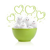 Happy painted eggs in a bowl Stock Photos