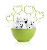 Happy painted eggs in a bowl Stock Images