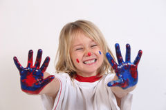 Happy painter. A cute little girl who got into the paints stock photos