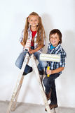 Happy painter kids on a ladder Stock Image