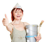 Happy painter holding thumbs up. Happy painter with paint and brushes holding thumbs up Stock Image