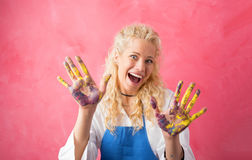 Happy painter with paint on her hands Royalty Free Stock Photography