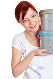 Happy painter woman with paint. Happy painter woman with two paint buckets Royalty Free Stock Images