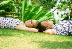 Happy pair. Lying on a grass Stock Photography