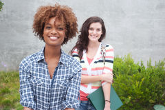 Happy pair of college students Royalty Free Stock Images