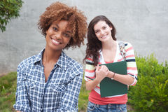 Happy pair of college students Stock Photography