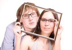 Happy pair in glasses in frame
