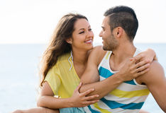 Happy pair having romantic date on sandy beach Stock Images