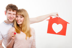 Happy pair holding symbols. Royalty Free Stock Photo
