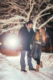 Happy pair loving each other in night park  filtered photo with flash flare Stock Photo