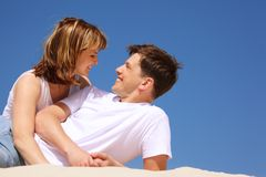 Happy pair plays on the beach Stock Photo