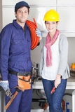 Happy pair of plumbers Stock Images