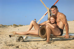 Happy pair on sand Royalty Free Stock Photos