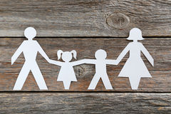 Happy paper family. On grey wooden background Royalty Free Stock Image