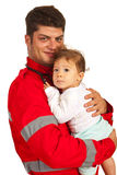 Happy paramedic with baby boy Royalty Free Stock Photo
