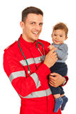 Happy paramedic and baby boy Stock Image