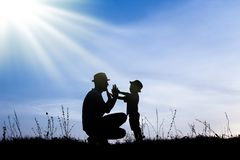 Happy parent with children playing on nature summer silhouette. Very Happy parent with children playing on nature summer silhouette royalty free stock image