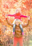 Happy parent and kid walking in fall outdoor Royalty Free Stock Photo