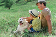Happy parent and son stroking Labrador pet Royalty Free Stock Photos
