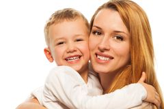 Happy parenting. Smiling and laughing young mother with five years old blond son Royalty Free Stock Photos