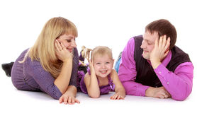 Happy parents admire its charming little daughter Stock Photography