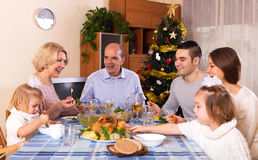 Happy parents with adult kids and grandchildren. Celebrating xmas Stock Images
