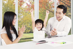 Happy parents applauding on their daughter Royalty Free Stock Photo