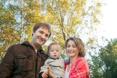 Happy parents with a baby Royalty Free Stock Photos
