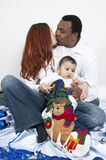 Happy parents and baby boy. Portrait with  parents kissing and baby boy Royalty Free Stock Photo