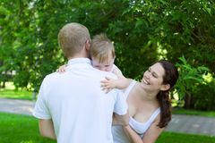 Happy parents with baby boy outdoors Royalty Free Stock Photos