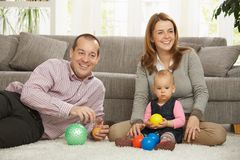 Happy parents with baby girl Stock Image