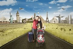 Happy parents with baby on the road to holiday Royalty Free Stock Images