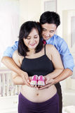 Happy parents with baby shoes Stock Photography