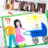 Happy parents with a baby in a stroller Royalty Free Stock Photos