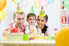 Happy parents celebrating birthday of kid son Royalty Free Stock Photo
