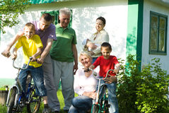 Happy parents and children. Play together outdoors Stock Photography