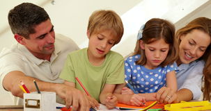 Happy parents and children drawing together stock footage