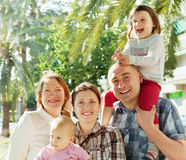 Happy parents with children and grandmother Stock Photo