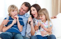 Happy parents and children having fun together Royalty Free Stock Image